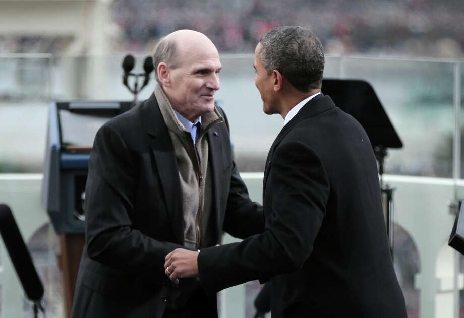 U.S. President Barack Obama greets singer James Taylor after his performance during the public ceremonial inauguration on the West Front of the U.S. Capitol January 21, 2013 in Washington, DC.   Barack Obama was re-elected for a second term as President of the United States. Photo: Win McNamee, Getty Images / 2013 Getty Images