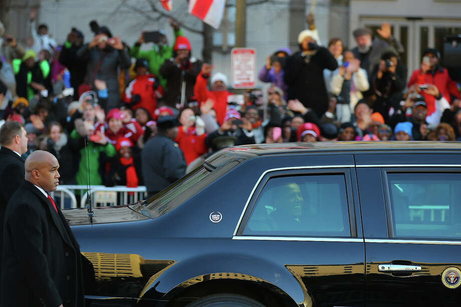WASHINGTON, DC - JANUARY 21:  U.S. President Barack Obama drives down Pennsylvania avenue in his vehicle during the Inauguration Parade on January 21, 2013 in Washington, DC.  The President was sworn in for second term. Photo: Joe Raedle, Getty Images / 2013 Getty Images