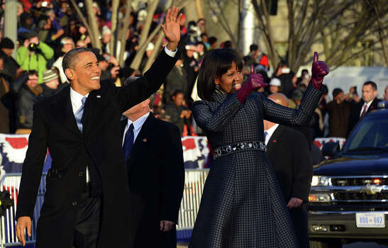 US President Barack Obama and First Lady Michelle Obama walk along Pennsylvania Avenue during the parade following Obama's second inauguration as the 44th US president on January 21, 2013 in Washington, DC.   AFP PHOTO/Jim WATSON Photo: JIM WATSON, AFP/Getty Images / 2013 AFP