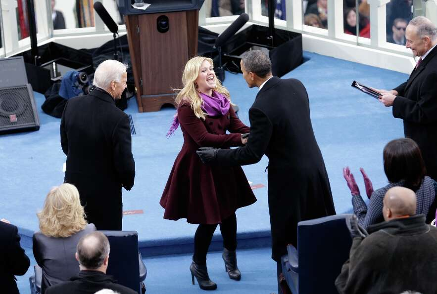 U.S. President Barack Obama greets singer Kelly Clarkson after her performance of My Country, 'Tis o