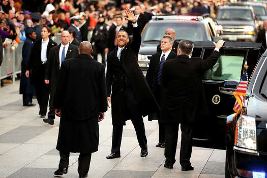 WASHINGTON, DC - JANUARY 21:  U.S. President Barack Obama waves as he exits the presidential limo as the inaugural parade winds through the nation's capital January 21, 2013 in Washington, DC. Barack Obama was re-elected for a second term as President of the United States. Photo: Chip Somodevilla, Getty Images / 2013 Getty Images