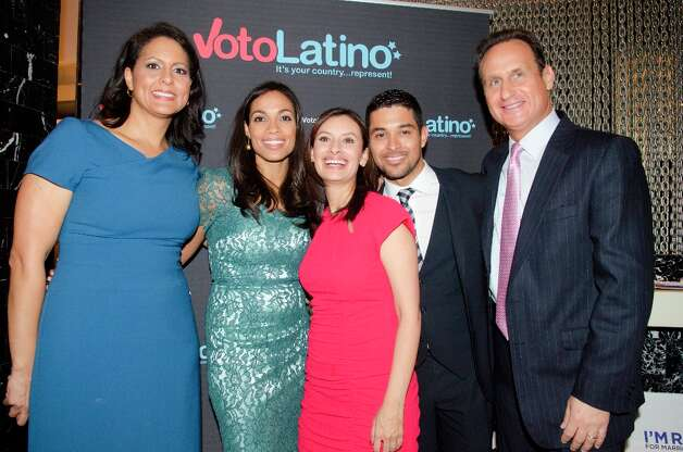 (L-R) Karen Finney, Rosario Dawson, Maria Teresa Kumar, Wilmer Valderrama and Jose Diaz Balart pose for a photo during the Voto Latino's 2013 Inauguration Celebration at Oya Restaurant on January 20, 2013 in Washington, DC. Photo: Kris Connor, Getty Images / 2013 Getty Images