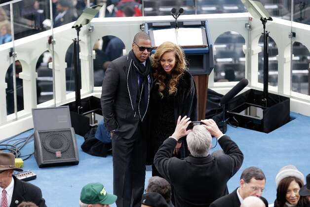 Jay-Z and Beyonce pose for a photo after the public ceremonial inauguration for U.S. President Barack Obama on the West Front of the U.S. Capitol January 21, 2013 in Washington, DC. Barack Obama was re-elected for a second term as President of the United States. Photo: Rob Carr, Getty Images / 2013 Getty Images