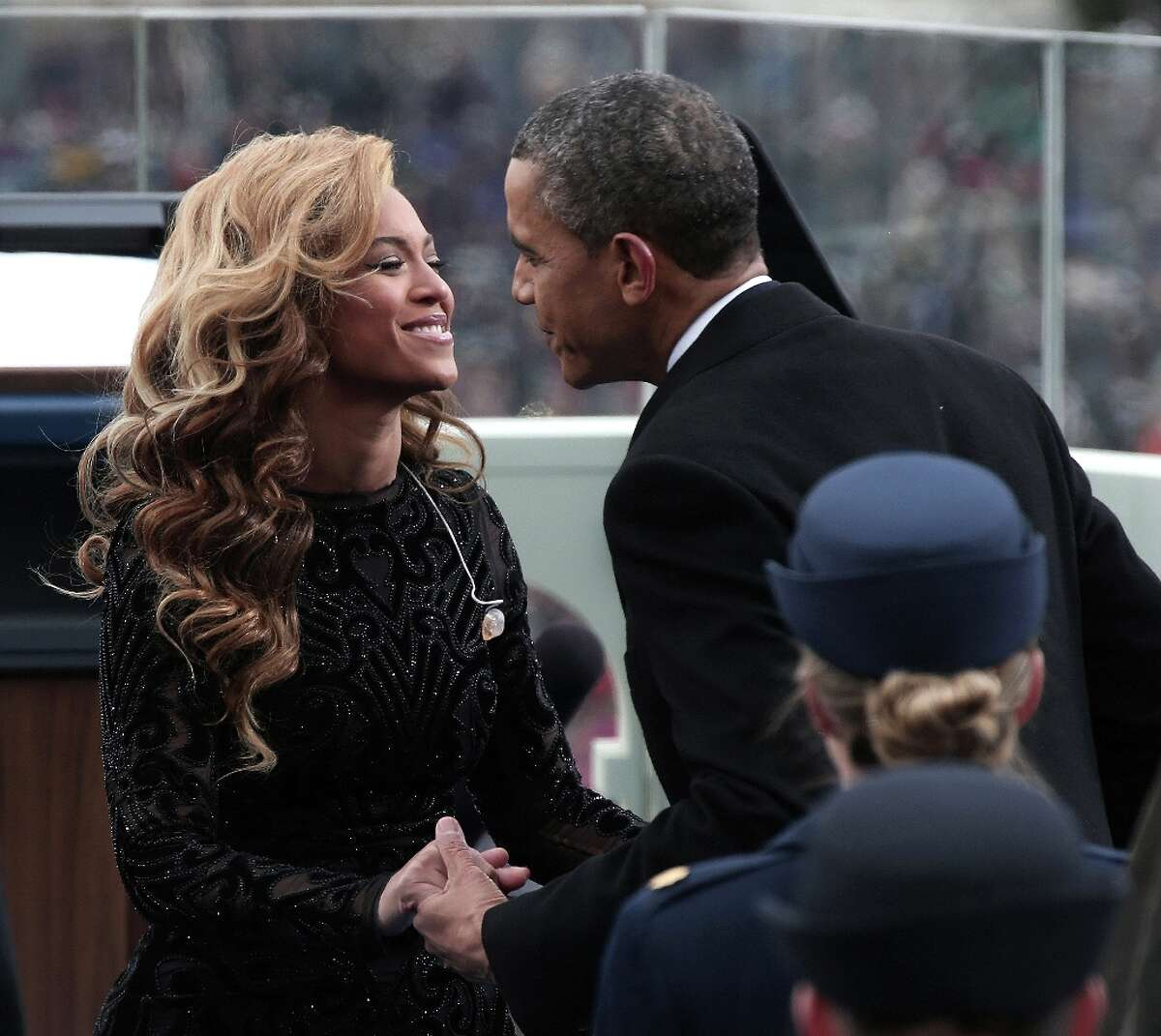 U.S. President Barack Obama greets singer Beyonce after she performs the National Anthem during the public ceremonial inauguration on the West Front of the U.S. Capitol January 21, 2013 in Washington, DC. Barack Obama was re-elected for a second term as President of the United States.