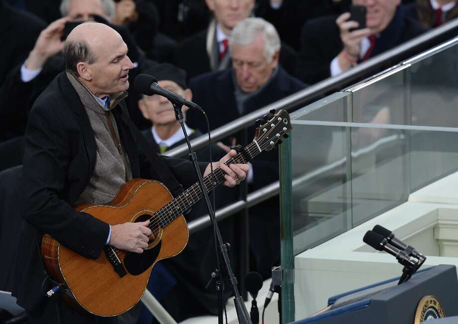 Musician James Taylor performs during the 57th Presidential Inauguration ceremonial swearing-in at the US Capitol on January 21, 2013 in Washington, DC. Photo: SAUL LOEB, AFP/Getty Images / AFP