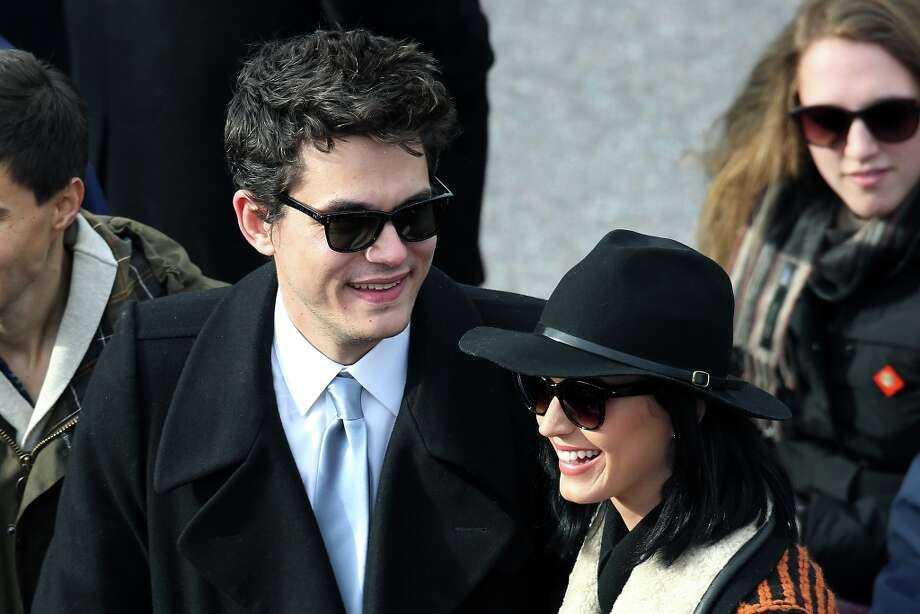 Musicians John Mayer and Katy Perry attend the presidential inauguration on the West Front of the U.S. Capitol January 21, 2013 in Washington, DC. Barack Obama was re-elected for a second term as President of the United States. Photo: John Moore, Getty Images / 2013 Getty Images