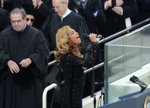 Singer Beyoncé performs during the 57th Presidential Inauguration ceremonial swearing-in at the US Capitol on January 21, 2013 in Washington, DC. Photo: SAUL LOEB, AFP/Getty Images / AFP