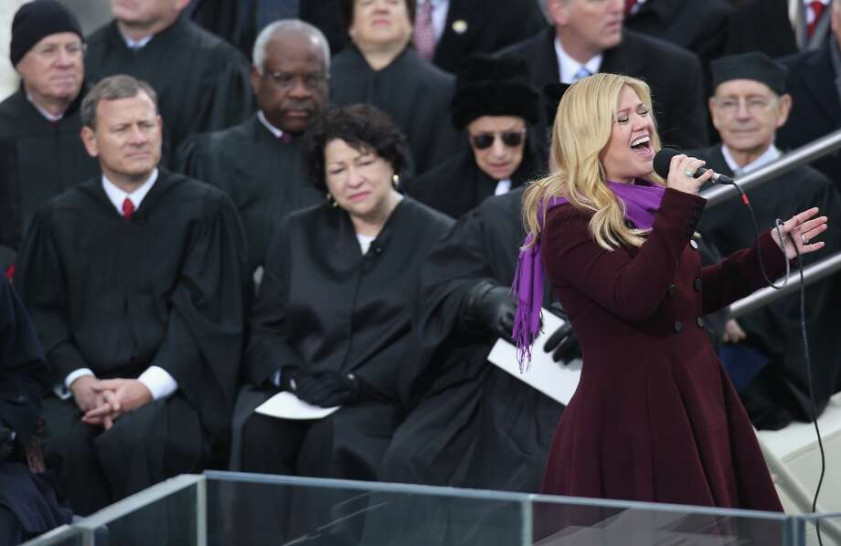 Singer Kelly Clarkson (R) performs as Supreme Court Justices watch during the public ceremonial inauguration for U.S. President Barack Obama on the West Front of the U.S. Capitol January 21, 2013 in Washington, DC. Barack Obama was re-elected for a second term as President of the United States. Photo: John Moore, Getty Images / 2013 Getty Images