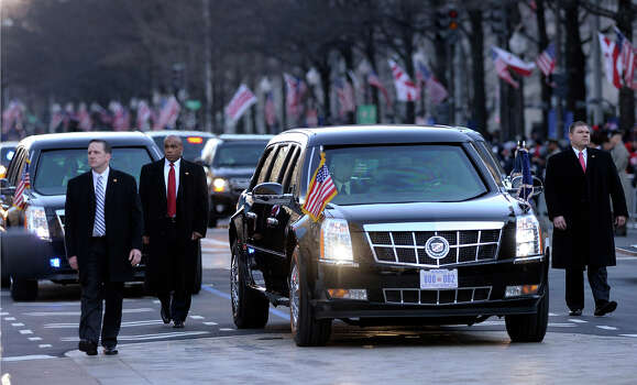 The presidential limousine with President Barack Obama and first lady Michelle Obama inside, heads down Pennsylvania Avenue in the Inaugural Parade after the ceremonial swearing-in for the 57th Presidential Inauguration on Capitol Hill in Washington, Monday, Jan. 21, 2013. Photo: Susan Walsh, AP / AP