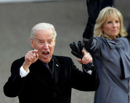Vice President Joe Biden reacts with his wife, Jill, as they walk down Pennsylvania Avenue en route to the White House, Monday, Jan. 21, 2013, in Washington. Thousands  marched during the 57th Presidential Inauguration parade after the ceremonial swearing-in of President Barack Obama. (AP Photo/Gerald Herbert) Photo: Gerald Herbert, ASSOCIATED PRESS / AP2013