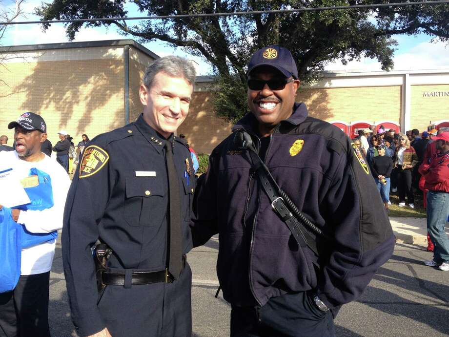 SAPD Chief William McManus and SAFD Fire Chief Charles Hood wait together for the start of the MLK march Jan. 21. Photo: Sarah Tressler/Express-News
