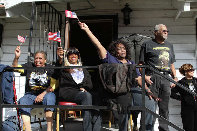 Birtha Bane, left, Francis Wright, center, and Jamesetta Grant, right, members of the American Legion, wave their American flags as the Martin Luther King Jr. March passes by. Photo: Bria Webb, San Antonio Express-News / ©2013 San Antonio Express-News