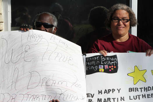 Twins Ronald Johnson, left, and Brenda Johnson, right, members of the Our Place Adult Daycare, watch as the Martin Luther King Jr. March begins. Photo: Bria Webb, San Antonio Express-News / ©2013 San Antonio Express-News