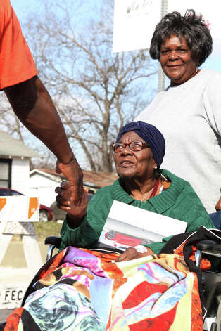 Dorris Appling, 87, who has been participating in San Antonio's  MLK march since it's beginning, sits off to the side greeting fellow marchers, along with her daughter Shirley Kelly. Photo: Bria Webb, San Antonio Express-News / ©2013 San Antonio Express-News