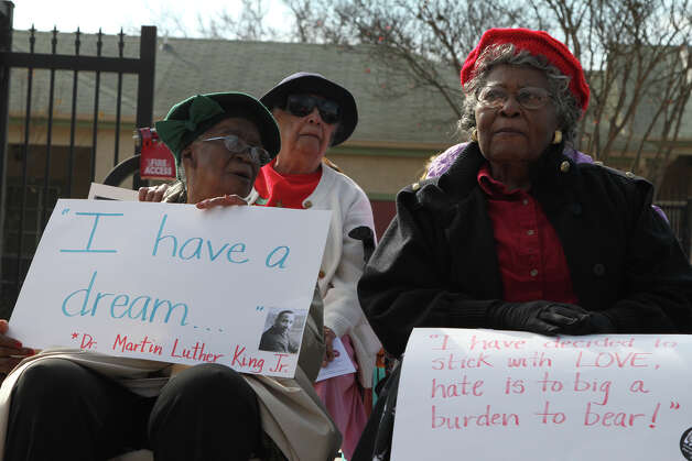 Residents of Mt. Zion Sheltering Arms, Loma Martinez, 82, right, and Erma Kidsy, 83,  watch as the Martin Luther King Jr. march passes by. Photo: Bria Webb, San Antonio Express-News / ©2013 San Antonio Express-News