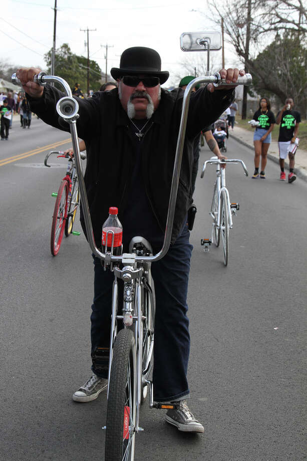 Rick Rios, a member of the Wild Dogs bike club, participates in the Martin Luther King Jr. March. Photo: Bria Webb, San Antonio Express-News / ©2013 San Antonio Express-News