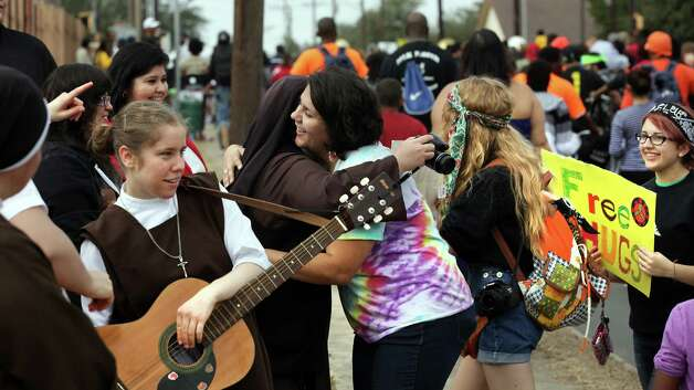 "Summer Hasan, center, gives a ""Free Hug"" to a Carmelite Sister on the parade route of the Martin Luther King, Jr. March.  Jan. 21, 2013.  Hasan is a member of Students for a Peaceful Society from Samuel Clemens H. S. Photo: BOB OWEN, San Antonio Express-News / © 2012 San Antonio Express-News"