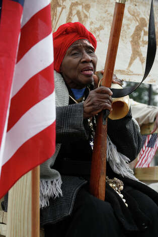 Ruth Stahaman acting as Harriet Tubman sings as she rides along  during the Martin Luther King Jr. March.Kalea Reed, 8, and Alia Fanagan, 9, members of the Vessels of Honor praise dance group dance before the start of the Martin Luther King Jr. March. Photo: Bria Webb, San Antonio Express-News / ©2013 San Antonio Express-News