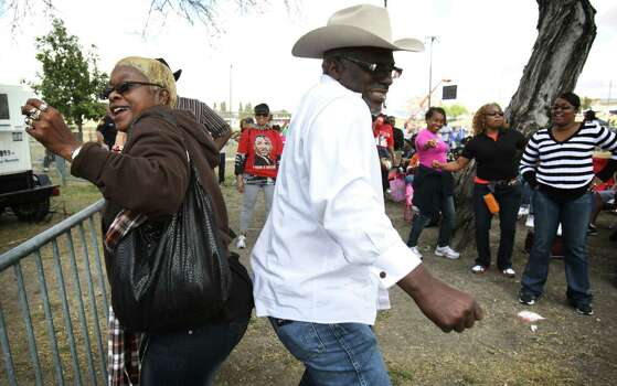 Brenda Faye Hoyle, left, dances with her husband Alfred Hoyle dance to the music of Archie Bell at the Martin Luther King, Jr. March where it ended at Pittman-Sullivan Park.  Jan. 21, 2013. Photo: BOB OWEN, San Antonio Express-News / © 2012 San Antonio Express-News
