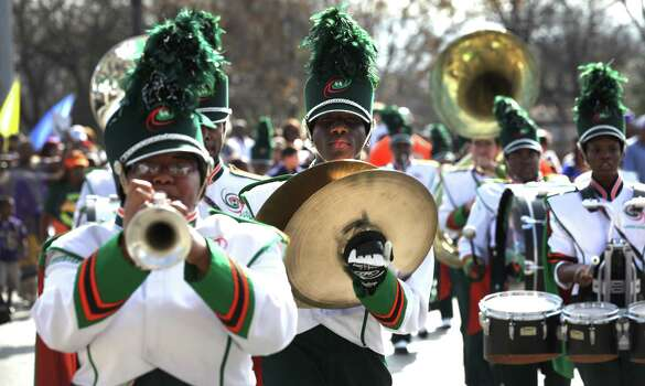 Tyrese Brown, center, plays the cymbals as the Sam Houston H. S. Marching Band participates in the Martin Luther King, Jr. March along MLK Blvd.  Jan. 21, 2013. Photo: BOB OWEN, San Antonio Express-News / © 2012 San Antonio Express-News