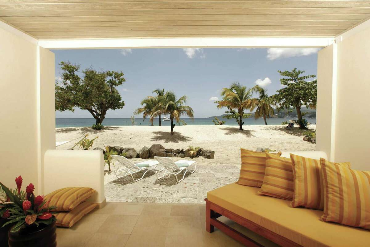 Suites at Grenada's Spice Island Resort are steps from the white-sand beaches