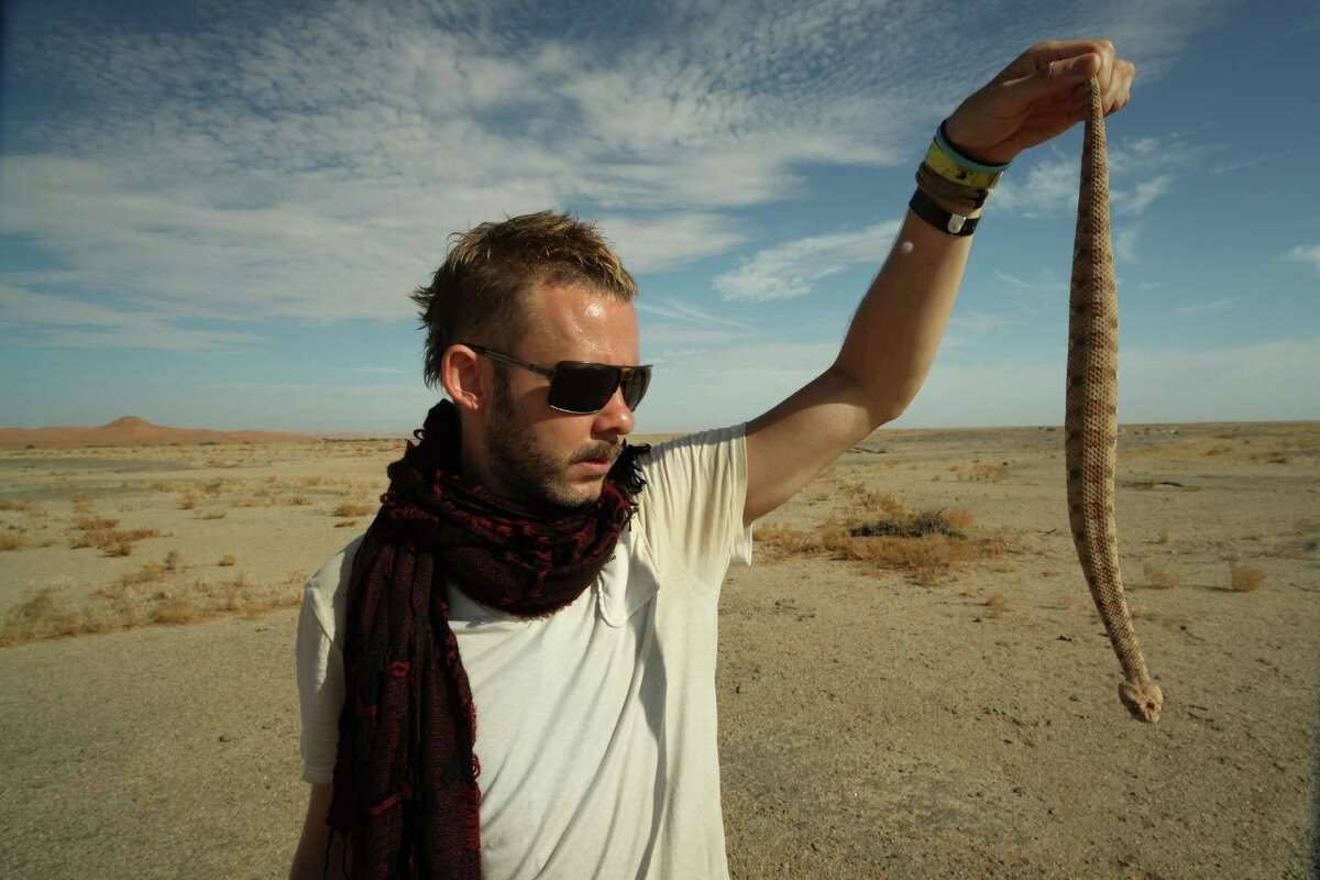 """Dominic Monaghan makes friends with a snake in Namibia in an episode of the BBC America series """"Wild Things with Dominic Monaghan."""""""