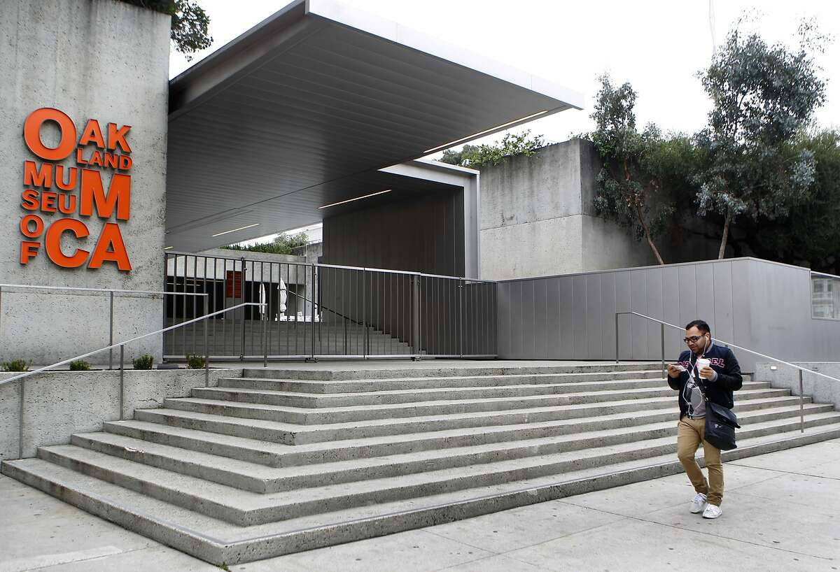 A man walks past the Oakland Museum of California in Oakland, Calif. on Wednesday, Jan. 9, 2013, where a thief stole a gold artifact, described as