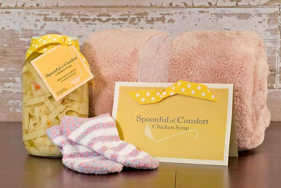 SpoonfulofComfort.com is a web site that delivers get-well, sympathy and college care packages to the recipients' door. The main product featured is a half-gallon of homemade chicken soup, along with a blanket and fuzzy socks. Photo: Courtesy Spoonful Of Comfort