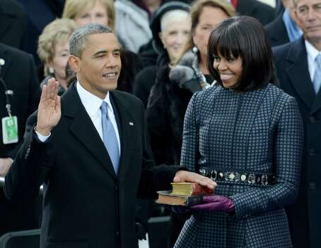 President Barack Obama takes the oath of office with Bibles used by Martin Luther King Jr. and President Abraham Lincoln and held by first lady Michelle Obama during the president's swearing-in at the Capitol. Photo: STAN HONDA, AFP/Getty Images / AFP