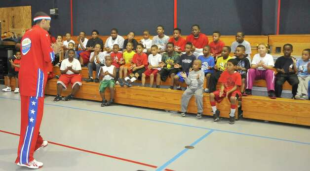 The Harlem Globetrotters' Cheese Chisholm visited the Salvation Army's Boys and Girls Club Monday afternoon at the 2350 IH-10 location.  He talked to all the kids about following their dreams as well as how to deal with bullies. He also did some ball handling drills with the kids.   The Harlem Globetrotters will be performing Tuesday night, January 21, 2013 at Ford Park.     Dave Ryan/The Enterprise Photo: Dave Ryan