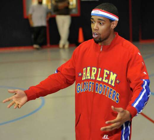 The Harlem Globetrotters' Cheese Chisholm, right, visited the Salvation Army's Boys and Girls Club Monday afternoon at the 2350 IH-10 location.  He talked to all the kids about following their dreams as well as how to deal with bullies. He also did some ball handling drills with the kids.  The Harlem Globetrotters will be performing Tuesday night, January 21, 2013 at Ford Park.     Dave Ryan/The Enterprise