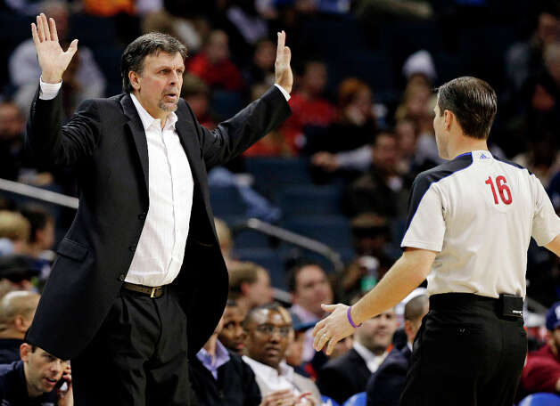 Rockets head coach Kevin McHale argues a call with referee David Guthrie, right, during the second half. Photo: Chuck Burton, Associated Press / AP