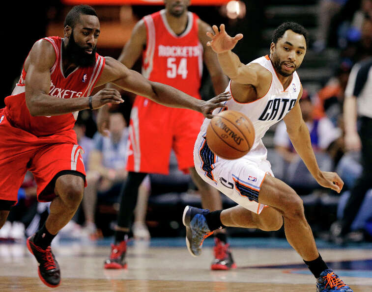 James Harden, left, and Gerald Henderson, right, chase after a loose ball during the second half.