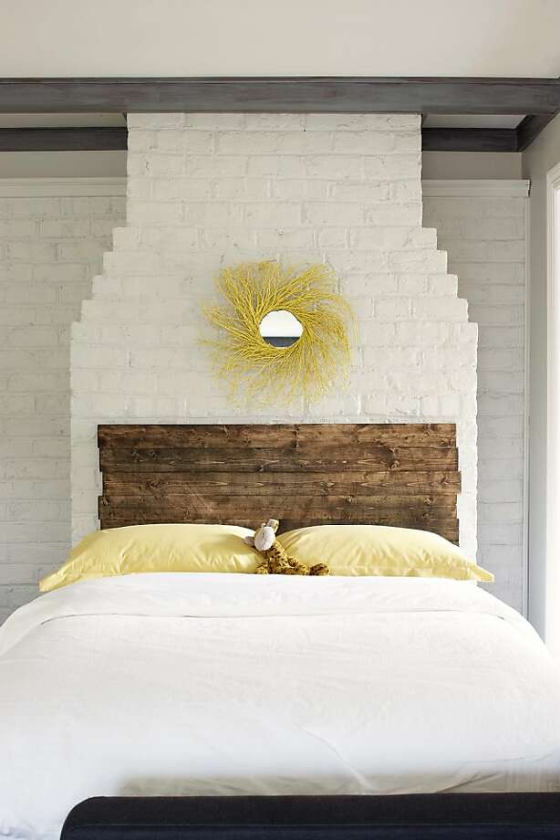 Slats of weathered wood are stacked to create a rustic-looking headboard in one of the simple projects from bloggers John and Sherry Petersik's new book. Photo: Kip Dawkins