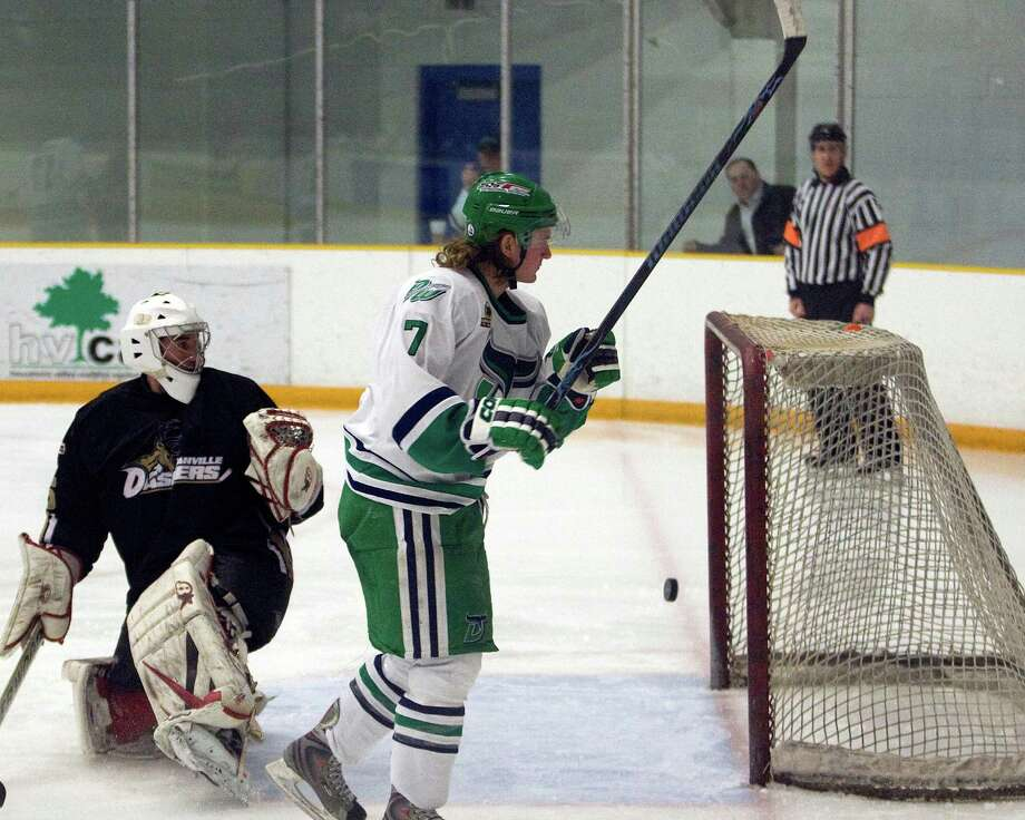 The Whalers' Mike Atkinson (7) amd Danville goalie Justin Sand both watch Atkinson's shot sail into the goal during an FHL game Monday at the Danbury Arena. Photo: Barry Horn / The News-Times Freelance