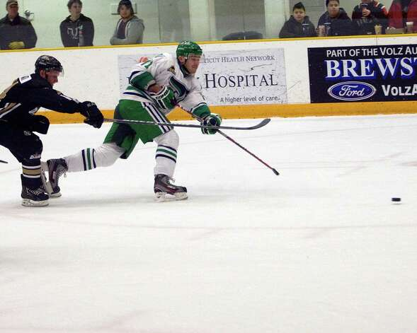 The Whalers' Kamil Vavra, right, blasts a shot against the Danville Dashers during an FHL game Monday at the Danbury Arena. Photo: Barry Horn