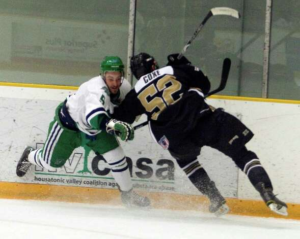 The Whalers' Carlo Ricci, left, and Danville's Henry Coxe battle along the boards Monday at the Danbury Arena. Photo: Barry Horn / The News-Times Freelance