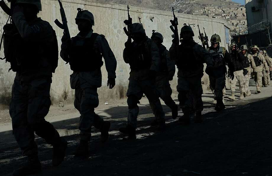 Afghan commandos patrol near the Kabul police facility that was attacked Monday by Taliban fighters.  Photo: SHAH MARAI, Stringer / AFP