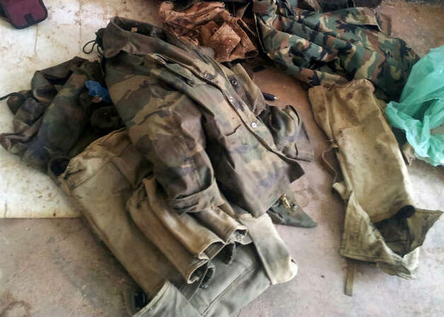 Military uniforms are displayed for the media after Islamist militants attacked the natural gas plant and took hostages at Ain Amenas, Algeria. The militants were wearing Algerian army uniforms and were equipped with explosives to blow up the plant, according to Algeria's Prime Minister Abdelmalek Sellal.