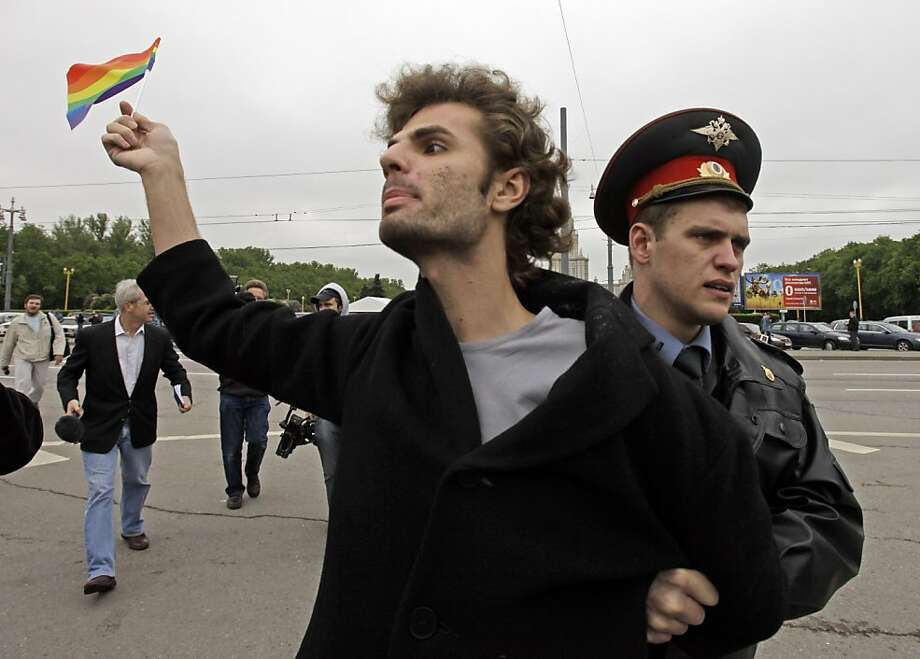 A gay-rights advocate is arrested in Moscow in 2009. A pending bill makes such activism illegal. Photo: Alexander Zemlianichenko, Associated Press