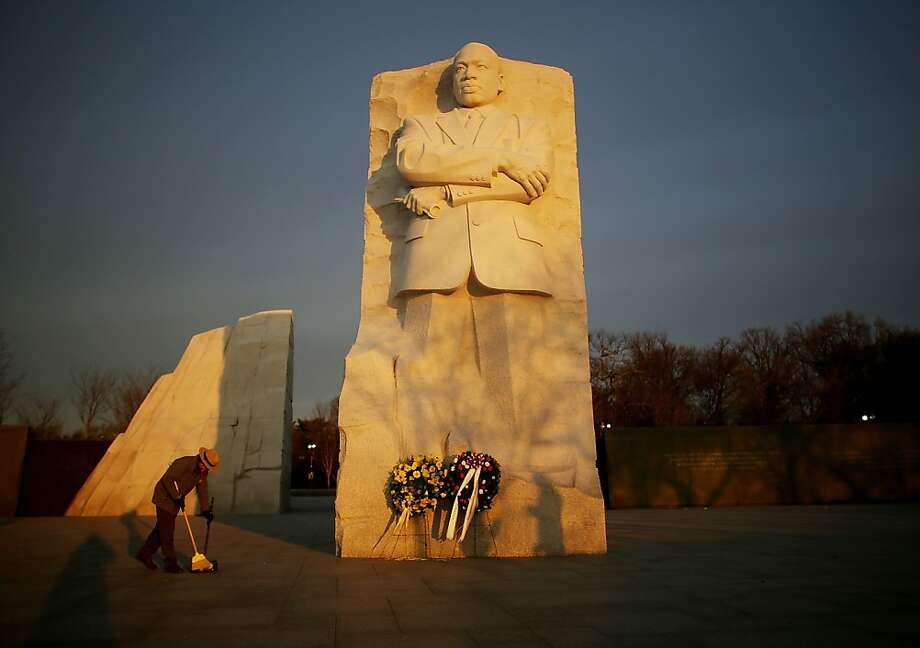 A park ranger cleans in front of the Martin Luther King Jr. Memorial in Washington at sunrise before the inaugural ceremony. Photo: Mario Tama, Getty Images