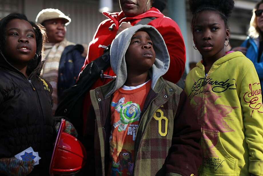 Makayla, Zachary and Brianna Donald-Saleem, all of Santa Clara, wait to begin marching in San Francisco. Photo: Mike Kepka, The Chronicle