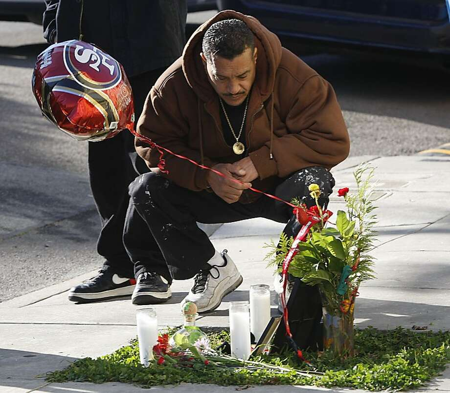 Neighbor Gustavo Manzanares at the site where Daniel Colon was shot dead. He remembers watching Colon, 43, grow up. Photo: Liz Hafalia, The Chronicle
