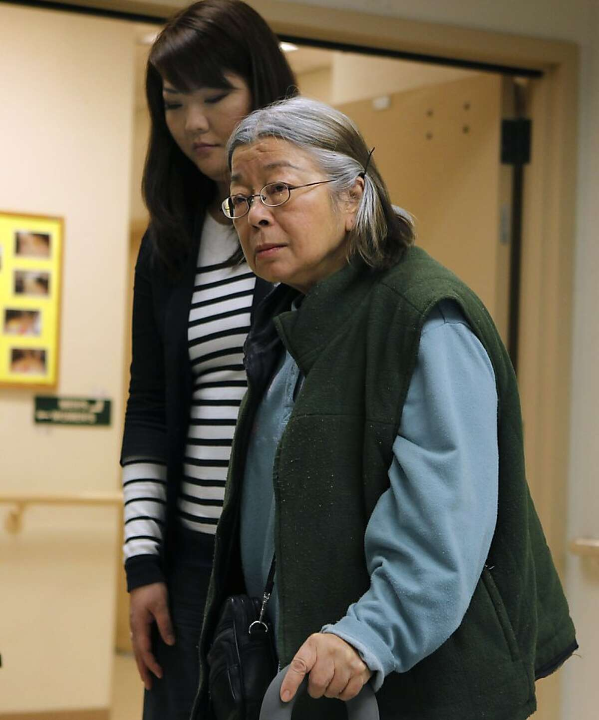 Jeannie Wong is assisted by Margaret Chao after describing her struggle with suicidal thoughts in San Francisco, Calif. on Wednesday, Jan. 16, 2013. Chao was one of the researchers on a study which focuses on suicide among the Chinese American senior population.