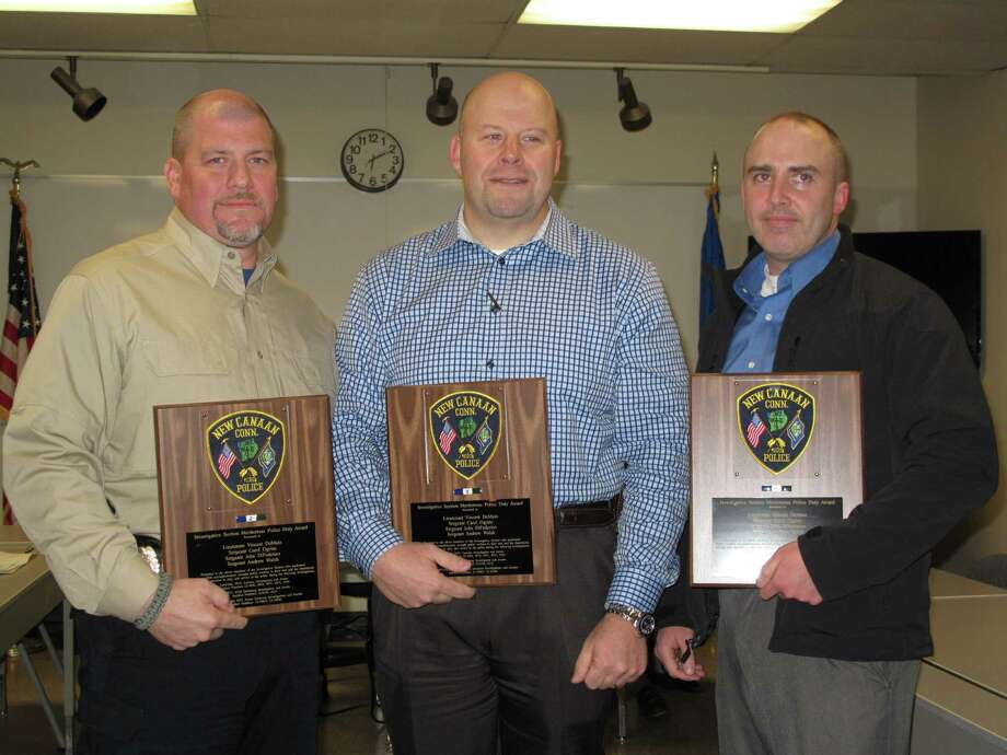 (l to r): Lieutenant Vincent DeMaio, Sergeant John DiFederico, and Sergeant Andrew Walsh receive the Investigative Section Meritorious Police Duty Unit Award on Jan. 17, 2013 at the New Canaan Police Commission meeting. Photo: Tyler Woods