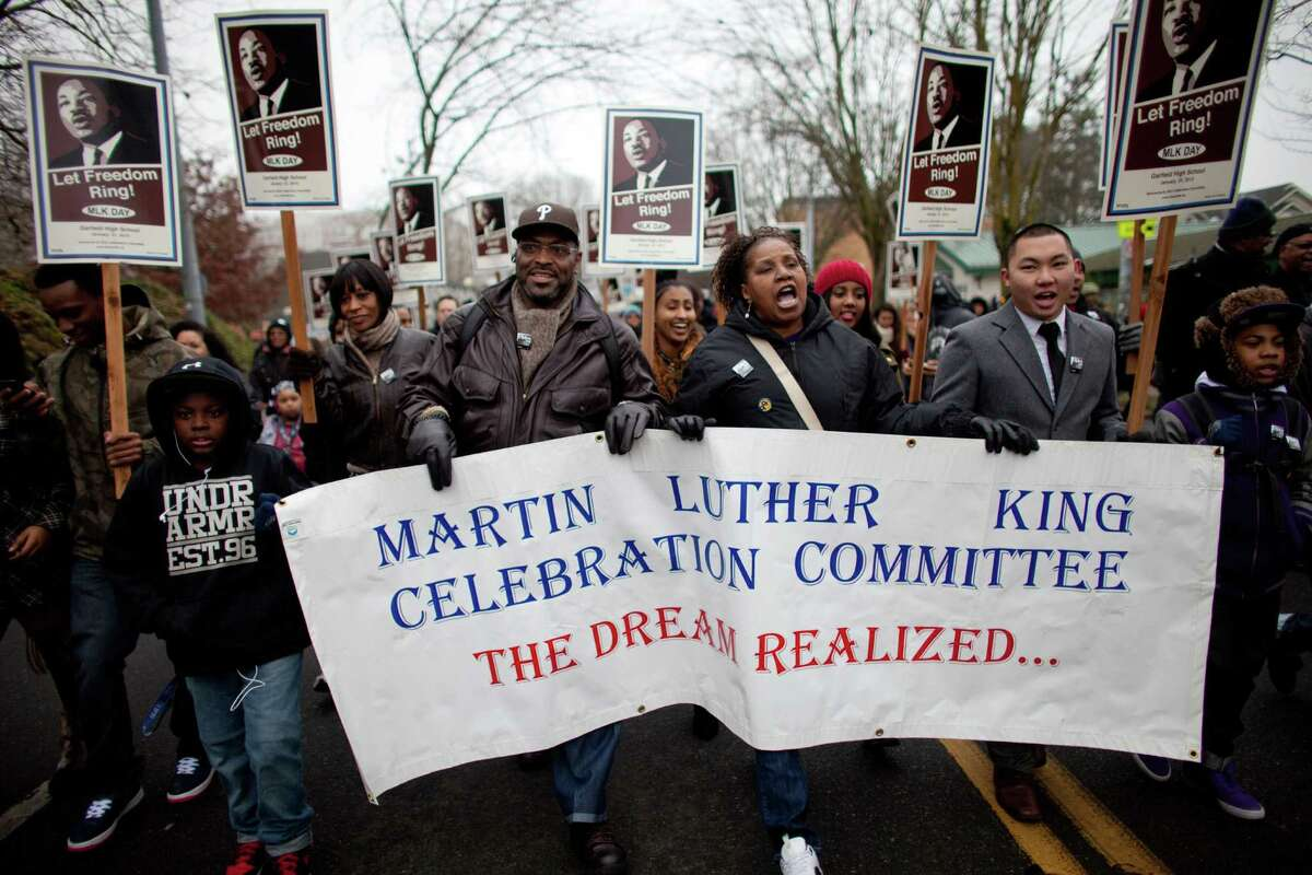 Participants walk through the Central District during Seattle's annual march to honor Martin Luther King, Jr. on Monday, January 21, 2013. The federal holiday recognizes the birthday of the civil rights leader.