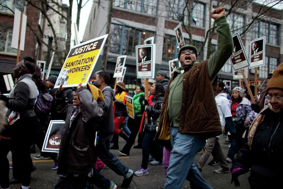 Participants march through Capitol Hill during Seattle's annual march to honor Martin Luther King, Jr. on Monday, January 21, 2013. The federal holiday recognizes the birthday of the civil rights leader. Photo: JOSHUA TRUJILLO, SEATTLEPI.COM / SEATTLEPI.COM