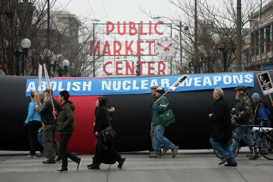 An inflatable missile is carried as a message against nuclear weapons during Seattle's annual march