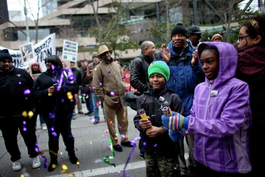 Reynaldo Jones, 10, and his sister Graciela Jones, 10, shoot confetti out of small canisters during Seattle's annual march to honor Martin Luther King, Jr. on Monday, January 21, 2013. The federal holiday recognizes the birthday of the civil rights leader. Photo: JOSHUA TRUJILLO, SEATTLEPI.COM / SEATTLEPI.COM
