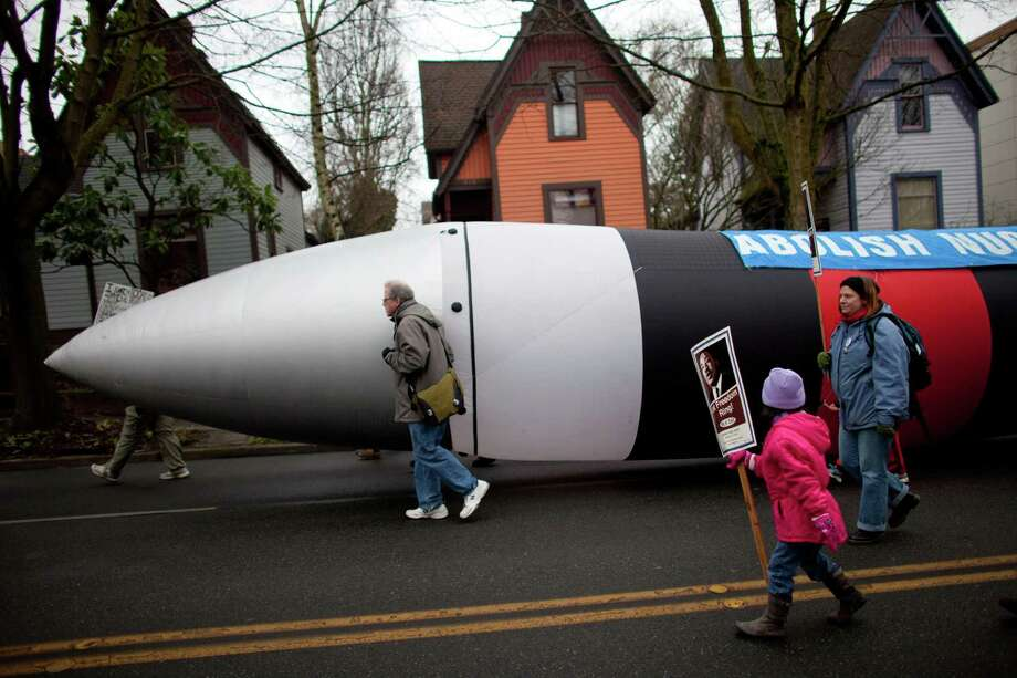 An inflatable missile is carried as a message against nuclear weapons during Seattle's annual march to honor Martin Luther King, Jr. on Monday, January 21, 2013. The federal holiday recognizes the birthday of the civil rights leader. Photo: JOSHUA TRUJILLO, SEATTLEPI.COM / SEATTLEPI.COM